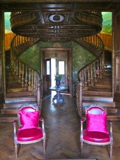 Chateau Clement entryway with double curved staircases