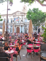 Plaza in front of the Hotel de Ville, lined with restaurants and cafes