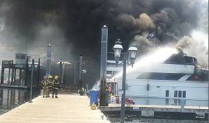 Firefighters fighting boat fire